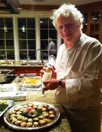 Longtime board member, Peter Dulligan, Chef-Owner of Griffin's Bar and Grill prepares hors d'oeuvres at the home of Scott and Alex Leibold.