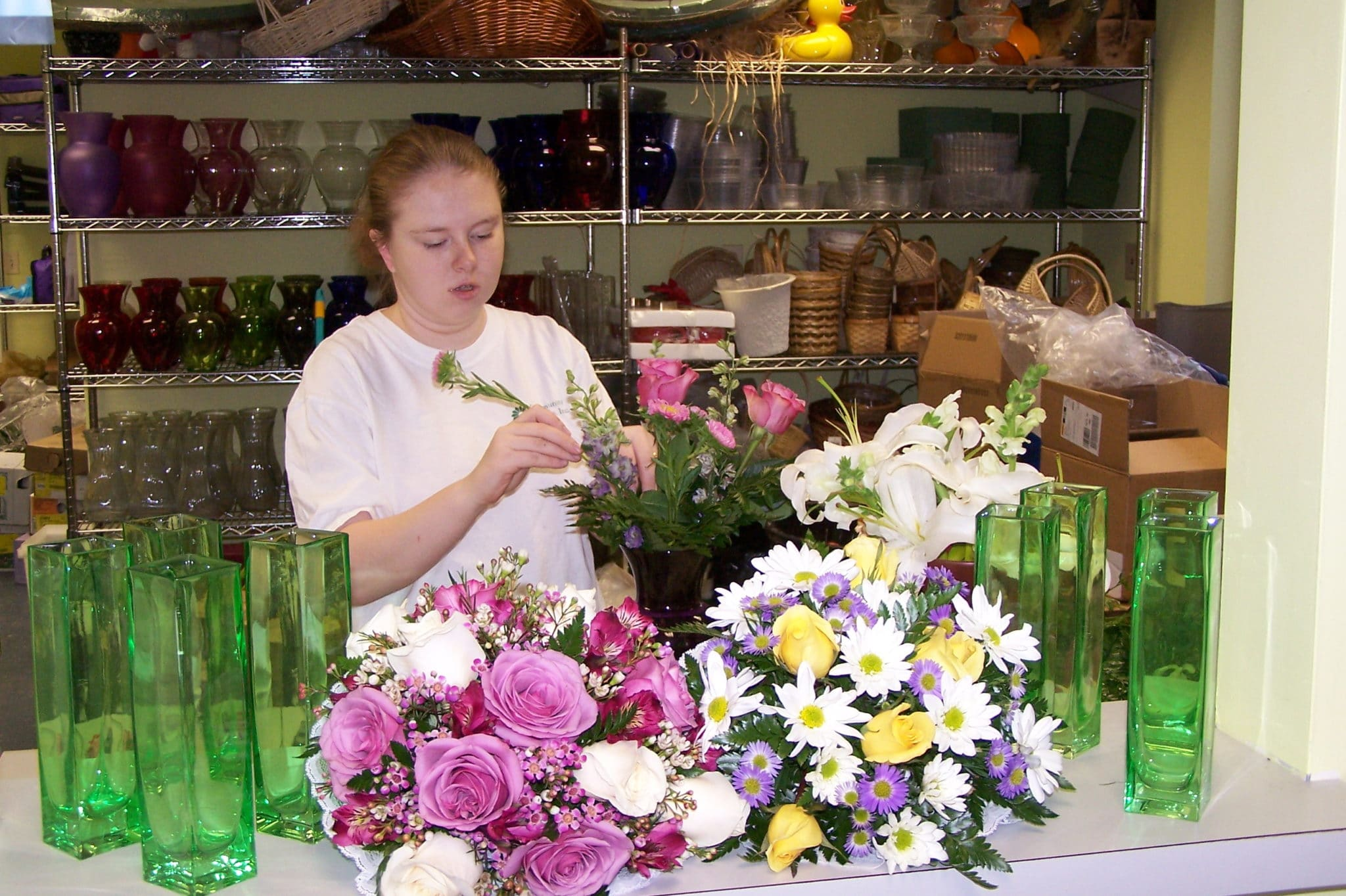 An employee arranging flowers