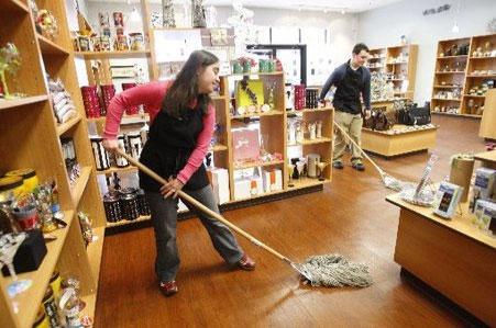 POM Susan Clavadetscher and Dan Reddington sweeping
