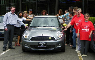 The group of recipients of the MINI Electric vehicles of Community Options, Inc.