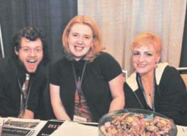 Steven Verba, far left, Melissa Alancourt, and Tara Loversidge of Community Options, which links its blog with Facebook, LinkedIn, and an E-mail blast program.