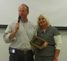 Wilkes accepting the Eddie C. Moore Award presented by Marge Brown, Community Options Board Trustee