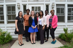 from L to R: Stefanie Rinaldi, Wendy Williams, Meghan Hunter, Deborah Napoleon, Teresa Snyder, Awee Taylor and Keaira Askew of Community Options gather outside Community Options' new STEP building. The building previously belonged to notable local newspaper, Town Topics.