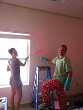 Several volunteers paint Peggy Sue's room in her favorite color, pink.