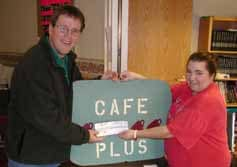 Luke Tynan of Syracuse won $1,000 in the 3rd Annual Community Options of Central New York Sweepstakes held in October. The sweepstakes was sponsored by local businesses, with a chinese auction and live music. Luke was presented the prize by Michelle DeLong, Community Support Staff