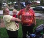 Jenny Windel, a person we provide support to in New mexico holds Sally Quinones baby Benny.