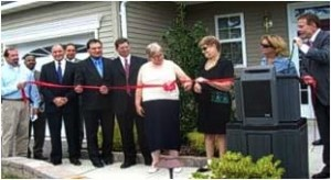 Featured in Photo: Rob Perotti - Kara Homes, Gregory Fenton - Acting Director, Division of Developmental Disabilities NJ Department of Human Services, Joe Manger - Chief of Police, Barnegat, NJ, James Smith, Joseph H. Vizari - Freeholder, Mayor Thomas E. Hartmen Jr., Nancy Seiler and Terry Morrison - Residents & Official Ribbon Cutters, Diane DOrazio - Executive Director, Ocean County, NJ & Robert Stack, President & CEO, Community Options, Inc.
