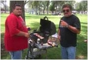 Lawrence Baca & Anthony Montano grill hamburgers for the Community Options Albuquerque Picnic, July 10, 2006.