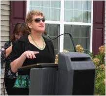 Terry Morrison addresses the crowd and thanks the people who made it possible for her to live outside the institution.