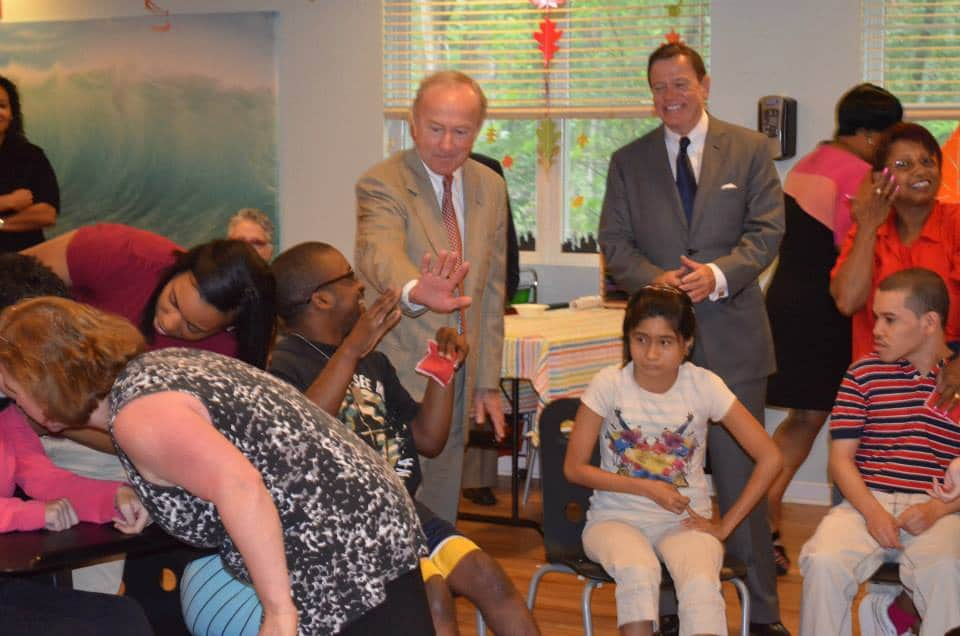 Congressman Frelinghuysen high fives Mo one of the students at the Red Ribbon Academy.