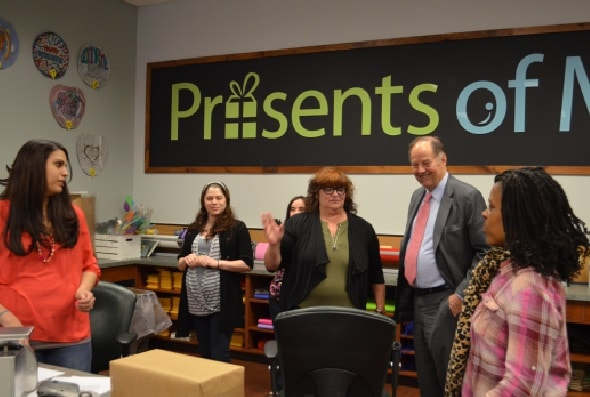 In May of 2014, Governor Thomas H. Kean, the 48th Governor of New Jersey, visits with the employees at Presents of Mind, a gift shop owned and operated by Community Options