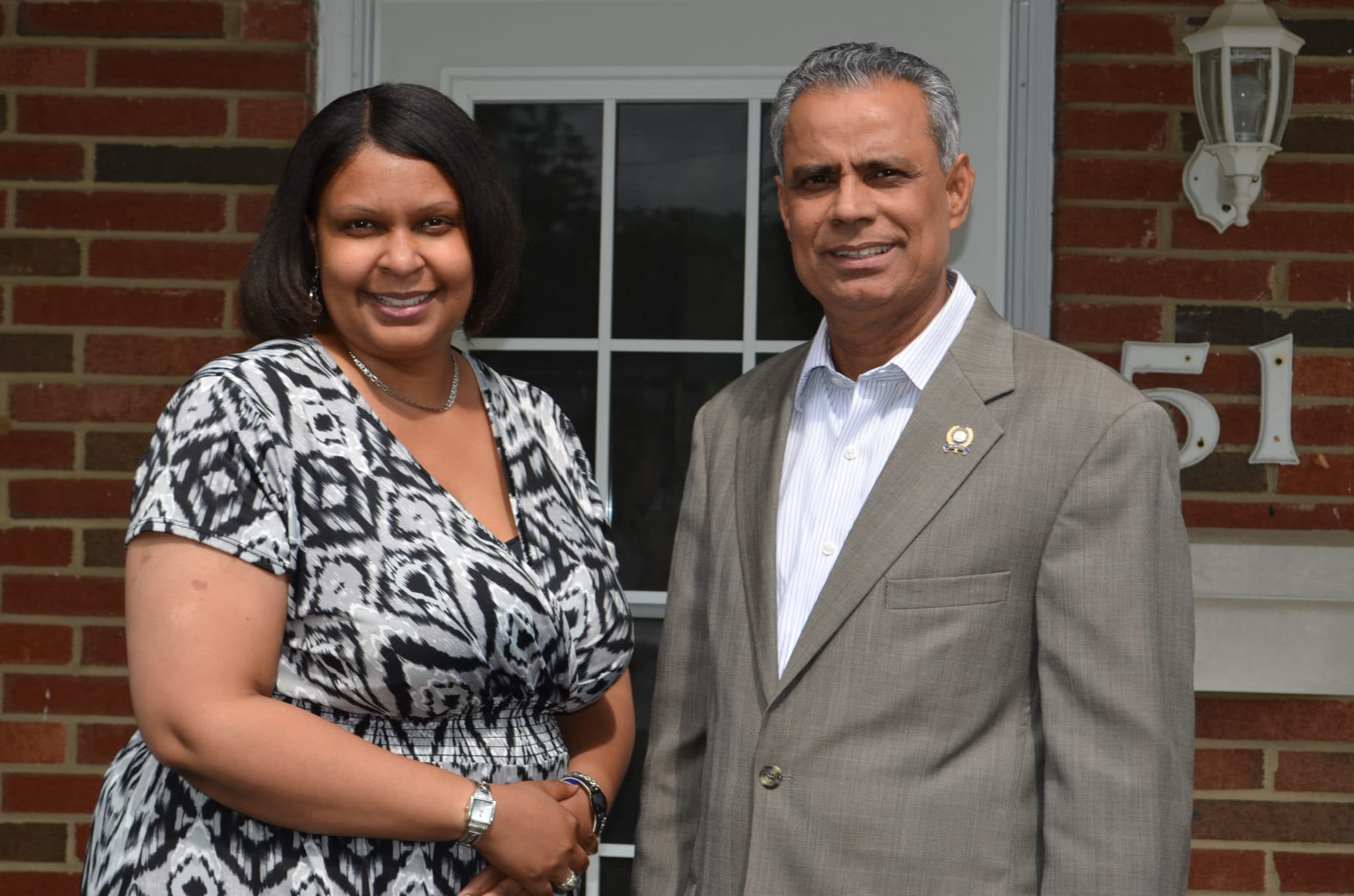 Community Options Executive Director Maria Bowles & Assemblyman Upendra Chivukula outside of our Monroe, NJ home.