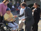 Wayne Mayor Scott Rumana shakes hands and signs autographs for Howard Newman after reading a proclamation at our Wayne office on October 22, 2007.