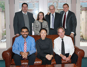 Featured in photo standing left to right: David Sweeney, Courtney Eidel, C. Herbert Schneider, Robert Stack, Dr. Baber Ghauri, Audrey Chen & Paul Hritz