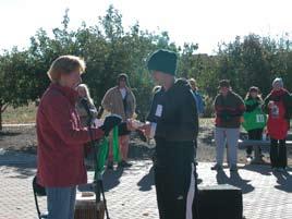 Erik Erickson receives medal from Maralie Waterman-BeLonge.