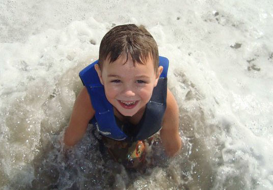 boy in water at imatter surf camp