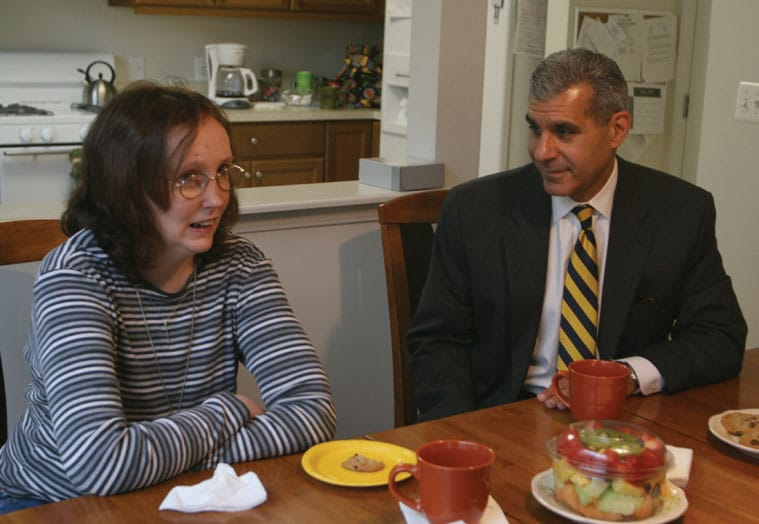 Susan Holston and Senator Joseph Kyrillos enjoy a cup of coffee at her Middletown group home.