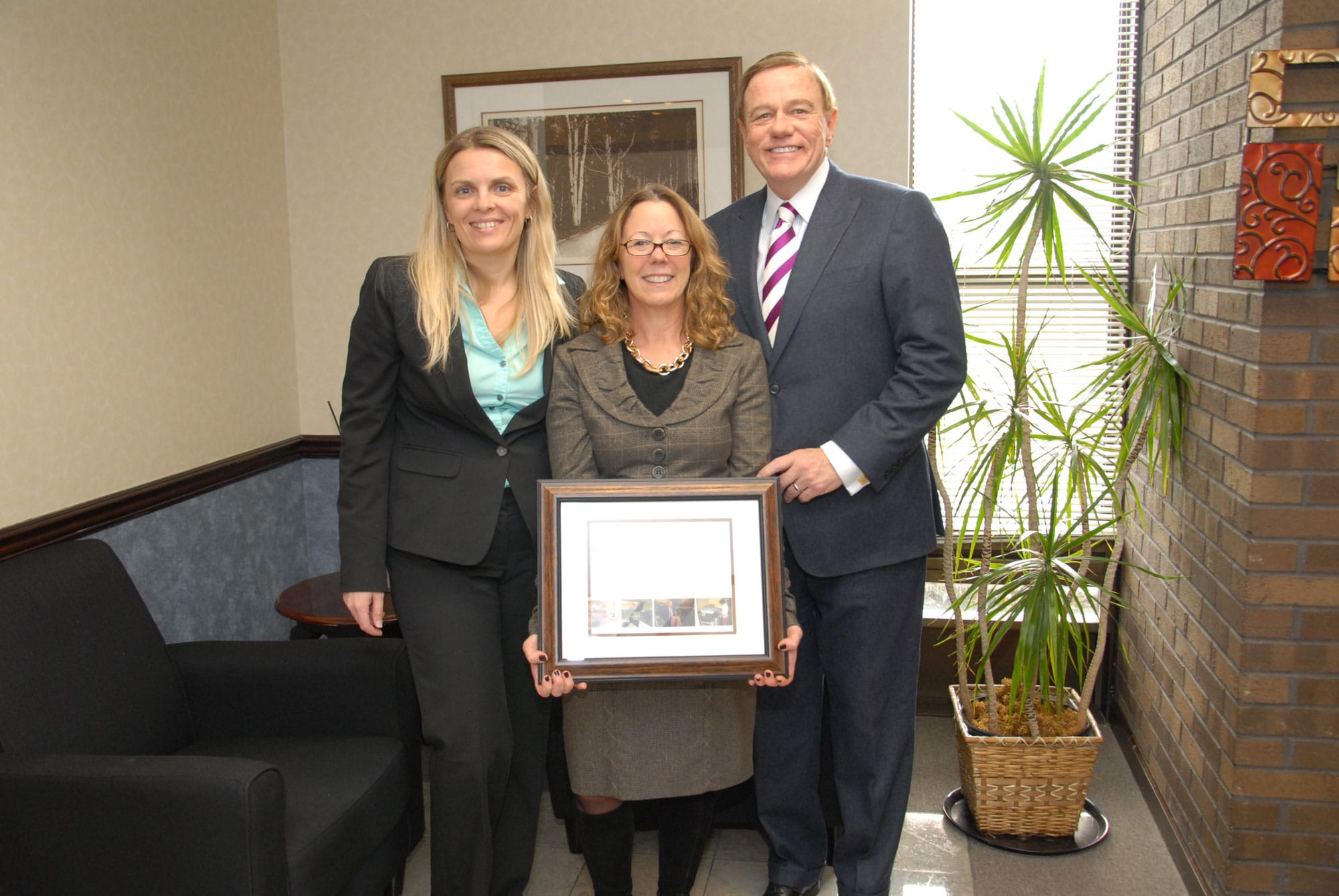 From left: Svetlana Repic-Qira, Regional Vice President of New Jersey for Community Options; Elizabeth Connolly Acting Commissioner of the New Jersey Department of Human Services; Robert Stack, Founder President and CEO of Community Options. Community Options presented Ms. Connolly with a plaque to commemorate her visit to the Daily Plan It in Princeton, New Jersey.