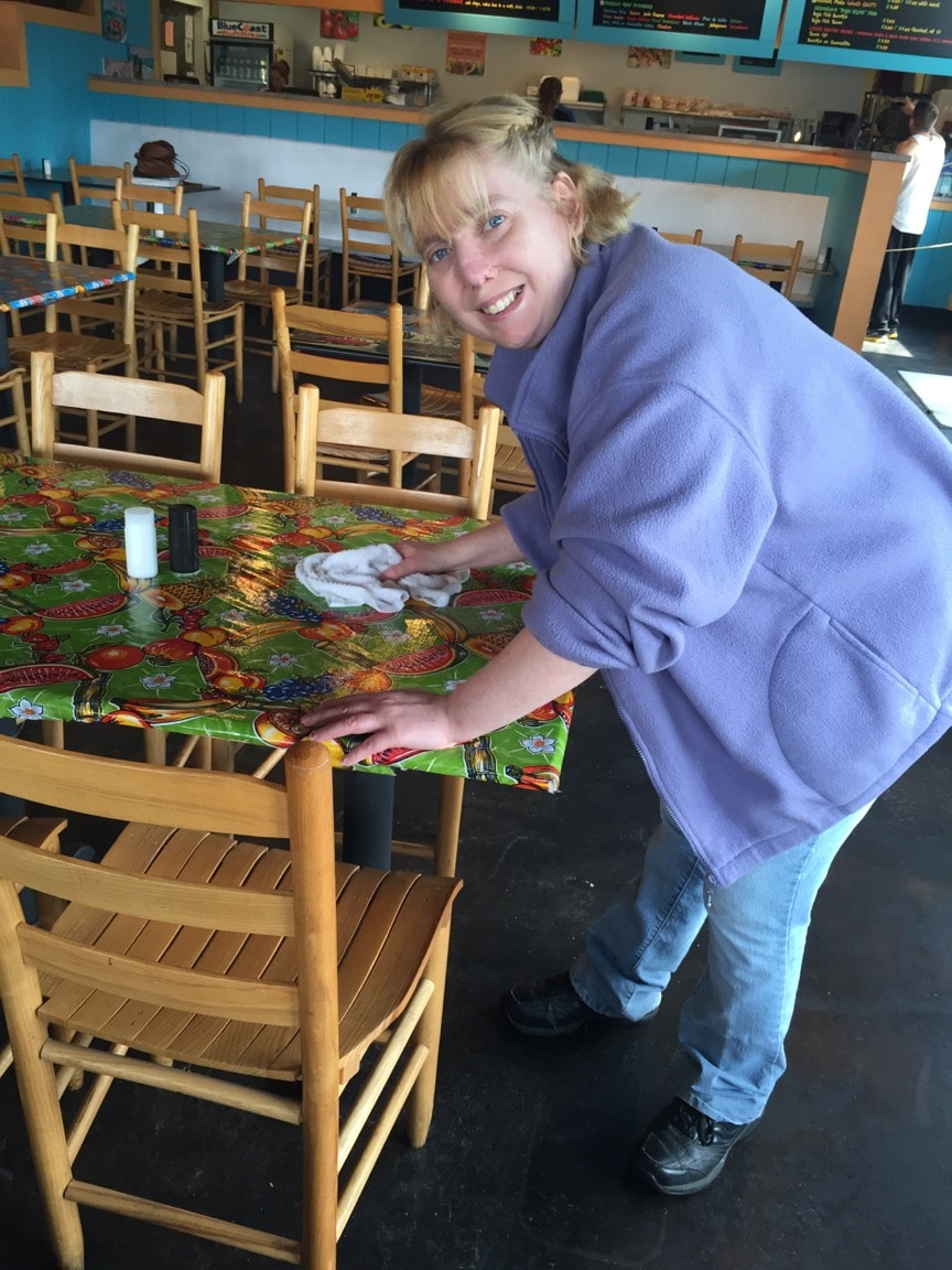 Amanda Cleaning The Table