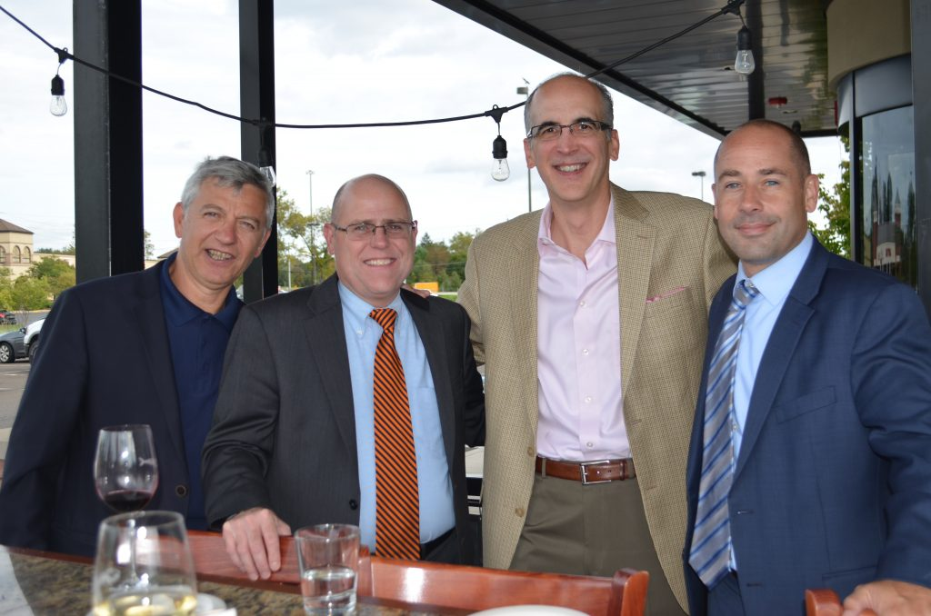 Members of the Carnegie Business Collaborative, Paolo Cerri, Christopher Kuhn, W.C. Jack Miller, Mick Cimorelli