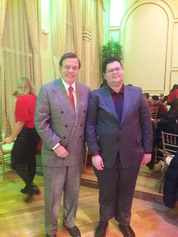 Damian (right) and Community Options President & CEO Robert Stack at the organization's recent holiday party in northern New Jersey.