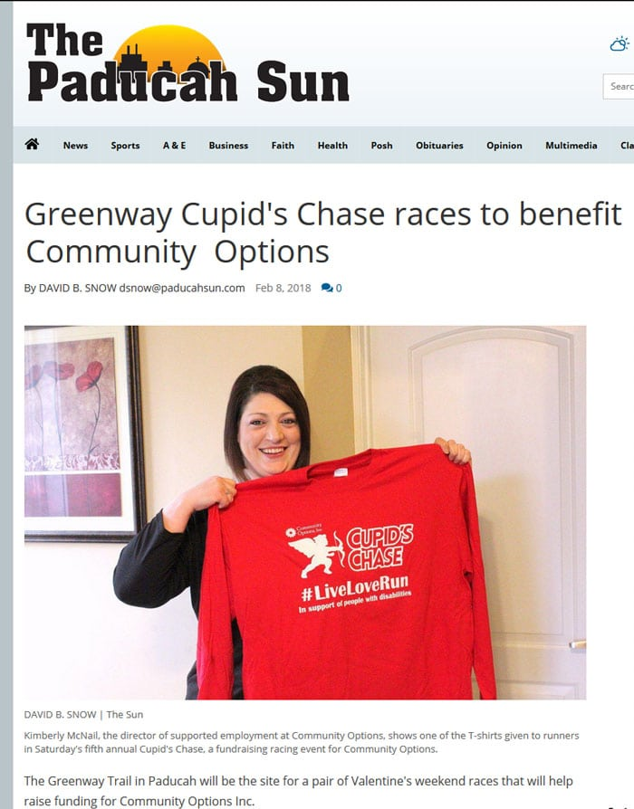 Kimberly McNail, the director of supported employment at Community Options, shows one of the T-shirts given to runners in Saturday's fifth annual Cupid's Chase, a fundraising racing event for Community Options.