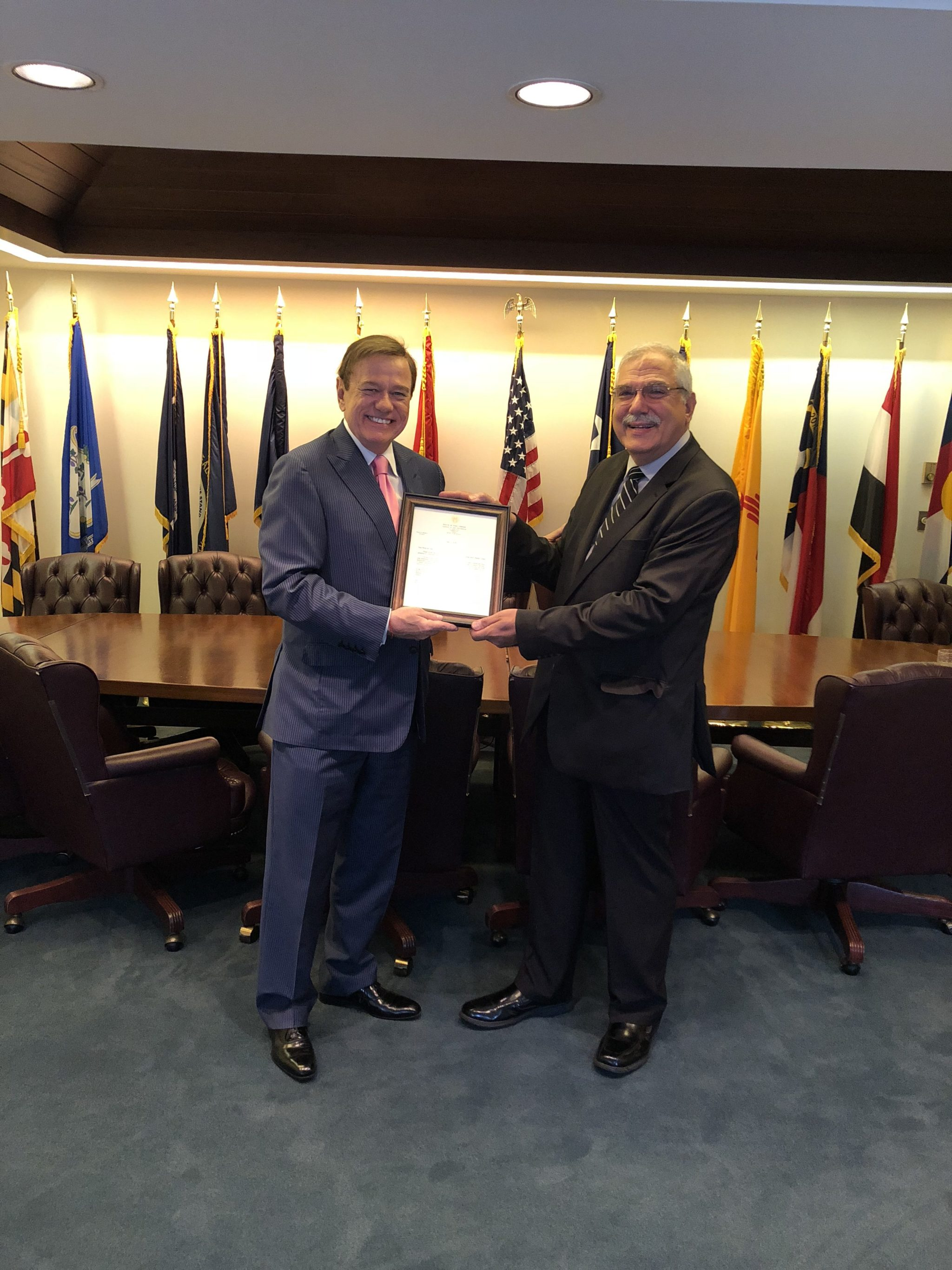 Robert Stack, President & CEO of Community Options presents the letter from Governor Murphy to Philip Lian.