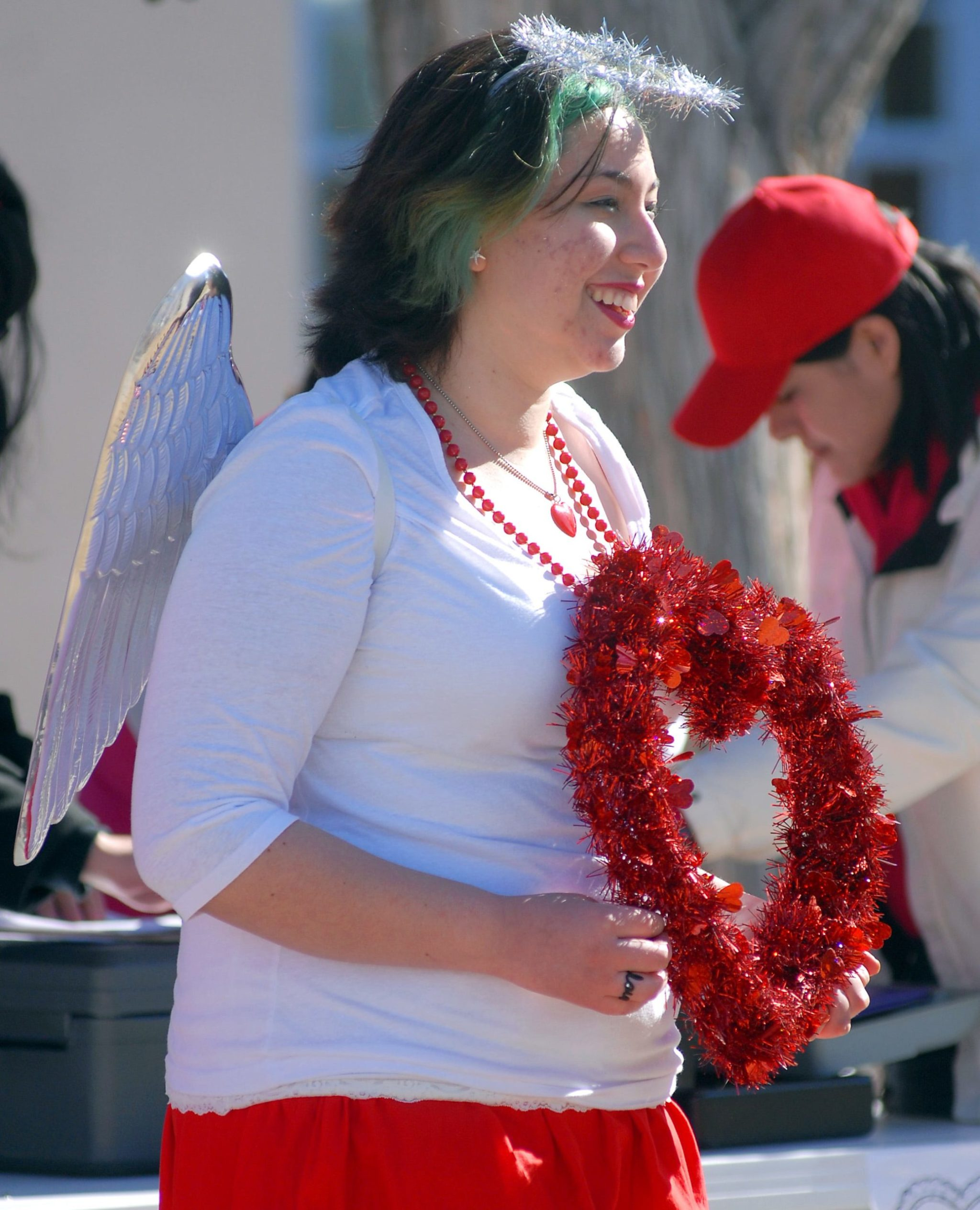 In this file photo, Erica Valdez, of Las Cruces, dresses as a Cupid the mascot for the Cupid's Chase 5K Run in the Mesilla Plaza on Saturday. (Photo: Robin Zielinski/Sun-News)
