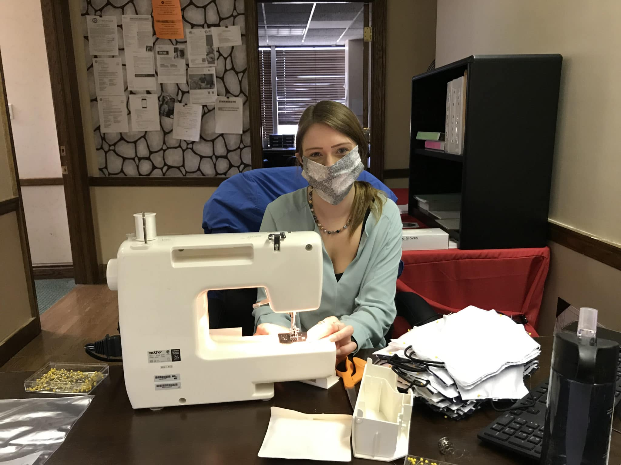 Brooke Smith, the new Administrative Assistant in Washington, PA at her sewing machine sewing masks