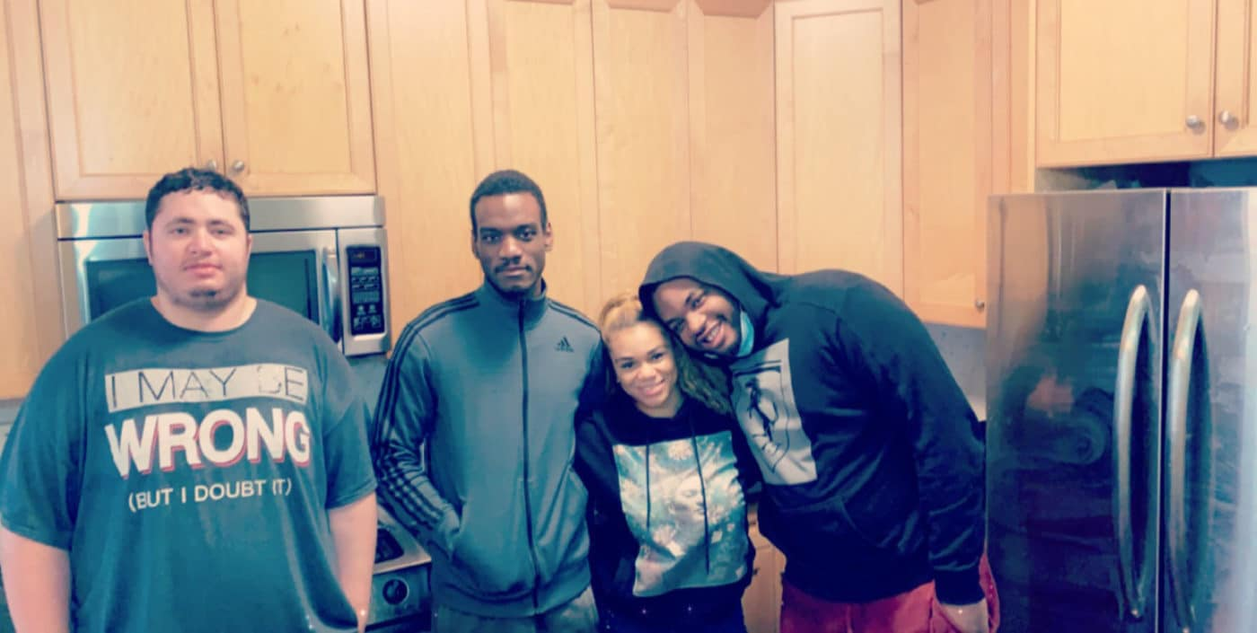 Christian, John, Latoya, and Anthony in the kitchen of a home in NYC
