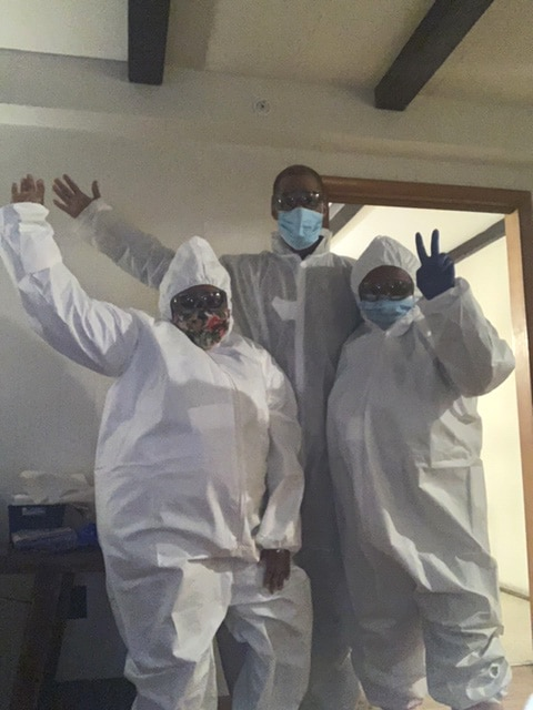 Nysheema Epps, Bryant DeShields, and Jerome White from Burlington, NJ donning their own personal protective equipment.