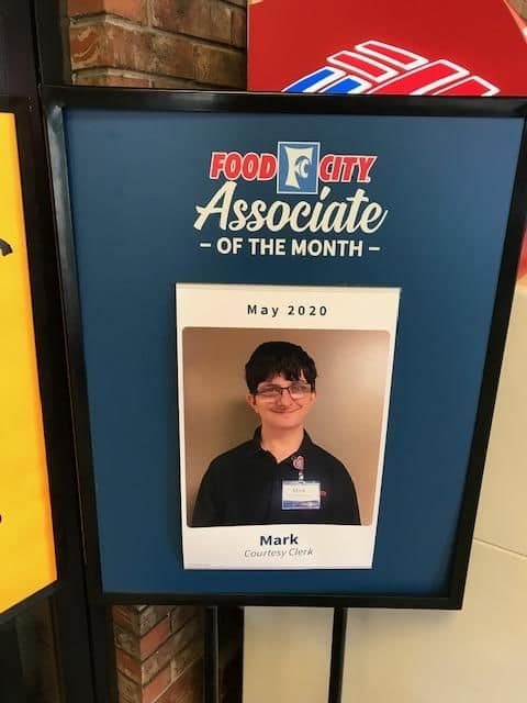 The food city employee of the month sign showing Johnson