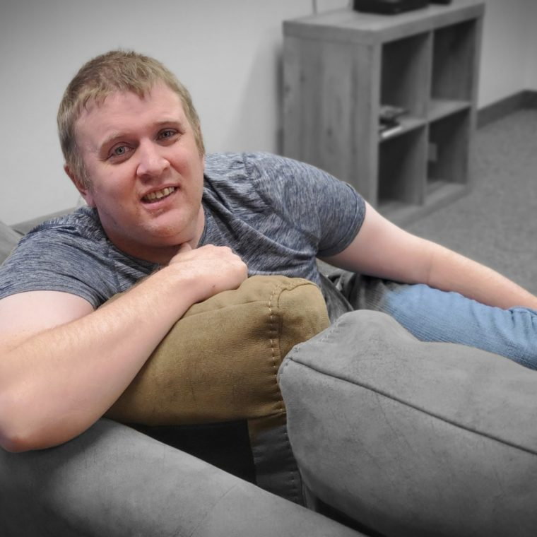 Ryan sitting on a comfy couch