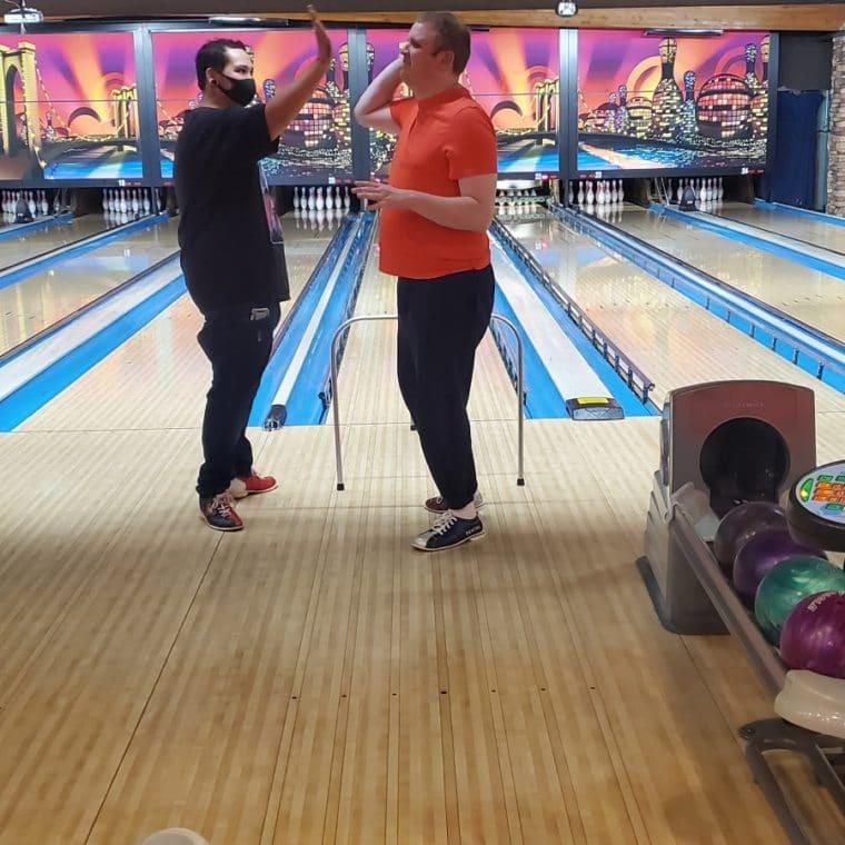 Ryan bowling giving someone a high five
