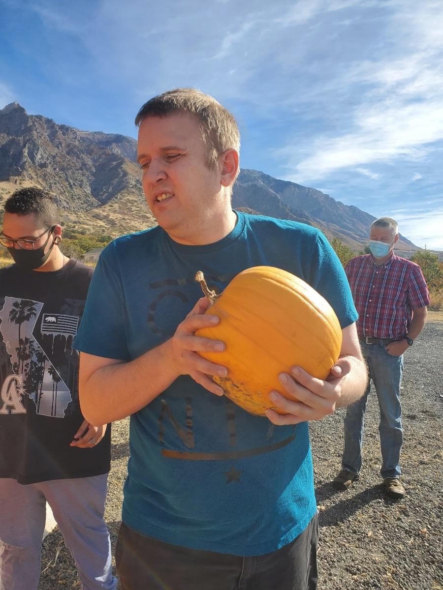 Ryan holding a pumpkin