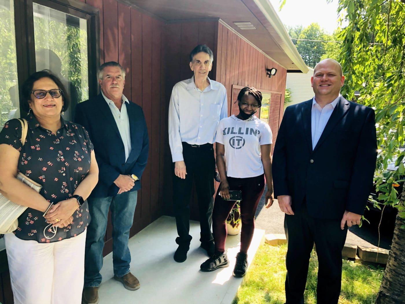 Ann Grover, Ken Bierman, Ron Schmalz, and Bryan Bidlack join Veronica McLean outside her new home.
