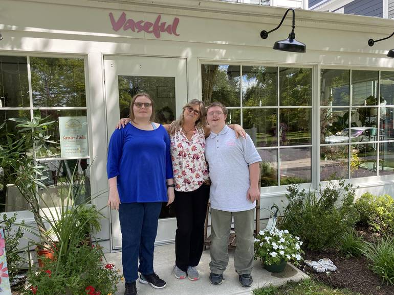 Kathy Angelinovich, center, manager at Vaseful Flowers at 305 Witherspoon Street, leans on her staffers from Community Options, Clare and Andrew - Photo Credit: TAPinto Staff