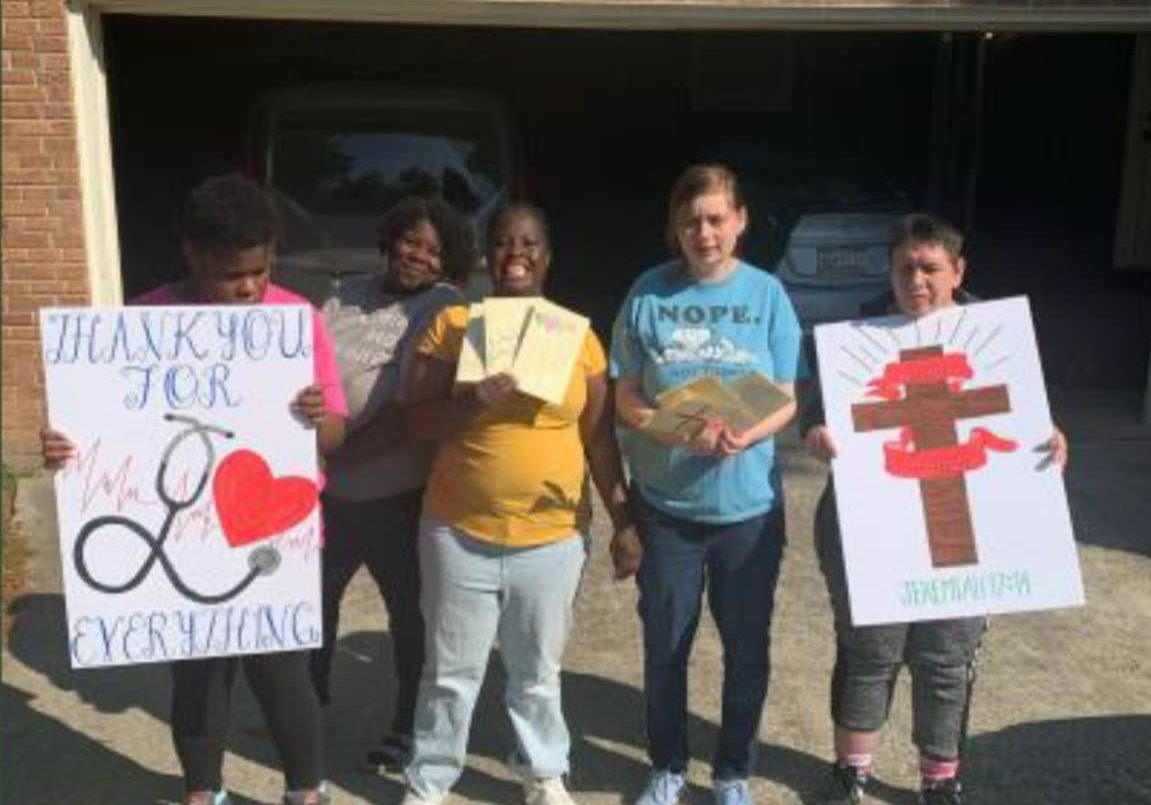 4 people two holding signs Cheering On Lexington Hospital Columbia, SC
